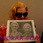 Special guest Mary Carlisle holds up a photo of her and Ann taken in 1929!
